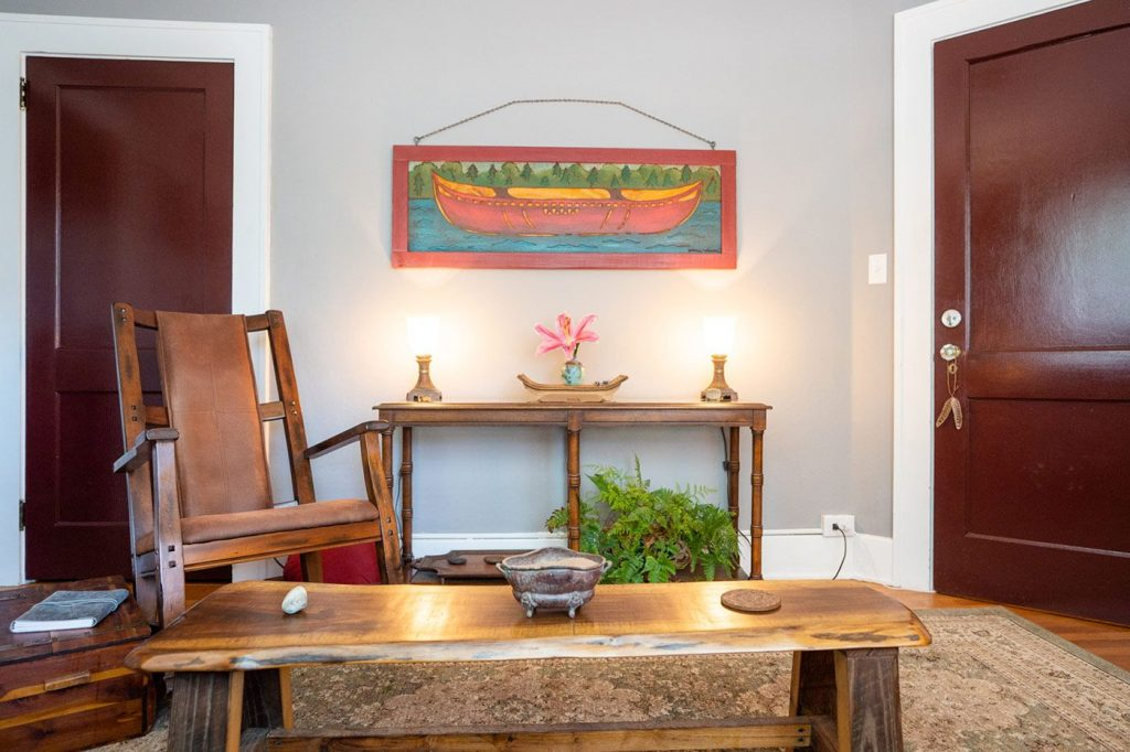 View of Pamela's office with wooden furniture, art, and flowers